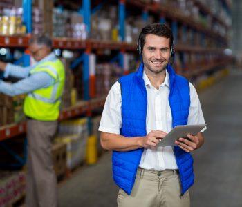 Warehouse worker holding digital tablet